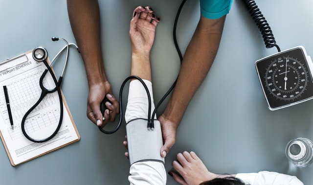 Nurse checking blood pressuure